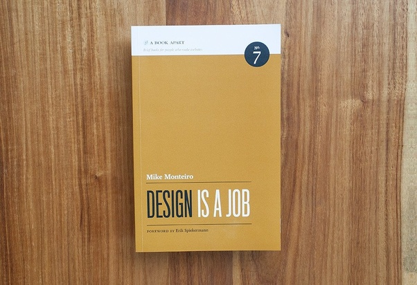"Cover buku ""Design is a Job"""