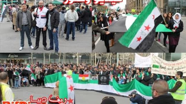 أبناء الجالية السورية في ألمانيا ومتضامنون في مسيرة حاشدة مطالبين برحيل بشار الأسد (فيديو وصور)