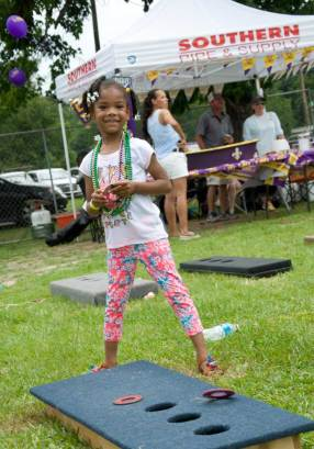 Young pretty girl smiling at Riff Ridgel Annual Crawfish cookoff