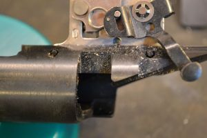 Note the locations of both trigger pins.  The front pin cannot be removed with the factory bolt stop in place.