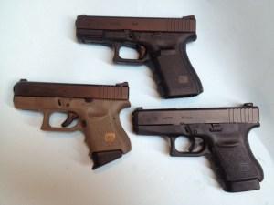 Generation 3 Glock 27 (left), Generation 4 Glock 19 (top, center) and Glock 36 (right).
