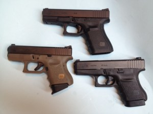 Generation 3 Glock 27 (left), Generation 4 Glock 19 (top, center) and Glock 36 (right).