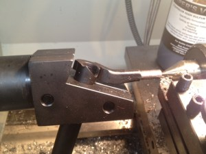 Once the major diameter of our 5/16x24 thread is reached, the tool post os retracted and the live center removed.
