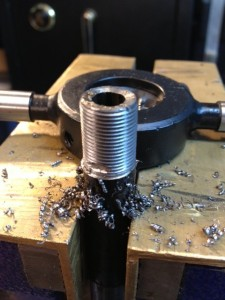 The 14x1mm left hand thread is cut. The surfaces are lubricated with Do Drill cutting oil while the cut is made.