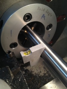 The machine set up gauge is used to level the high speed steel cutter to the centerline of the barrel.