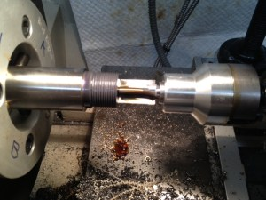 The bolt nose recess is cut with a piloted counterbore secured in a floating reamer holder.