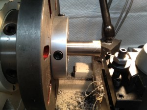 The barrel is mounted in a spider on the head stock of the lathe. We dial indicate off the outside sureface of the barrel and square the face prior to proceeding. NOTE: we left the barrel protruding longer then necessary fron the front edge of the spider in order to photograph the process. Normally, the barrel would not protrude this far.