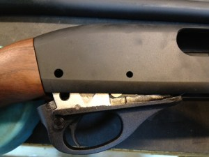 With the trigger plate pins removed, the trigger plate can be lowered from the receiver assembly.