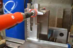 We decided to start our project by drilling the barrel hole.  We secured the RAZOR receiver in our milling machine vise against an angle plate.