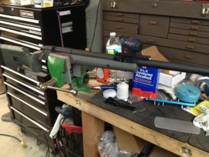 The rifle is assembled and the EFR's alignment is checked to make sure it is straight. Cotton swabs and denatured alcohol are used to clean up excess epoxy.