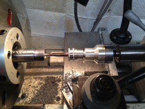 "The reamer is secured in a floating reamer holder.  The reamer is coated in a liberal amount of Viper's Venom cutting oil and slowing advanced .025"" into the barrel.  The lathe is then stopped, the reamer retracted, cleaned, lubricated, and reinserted a few thoussandths short of the previous cut.  This process is repeated until the reamer stop hits the end of the barrel blank."