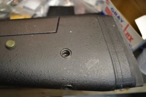 The hole is coated with Marine-tex epoxy and the stud is adjusted flush to the surface.  Any excess epoxy is cleaned from the area.