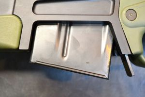To insert a magazine, the front edge is rocked into engage the notch on the magazine.
