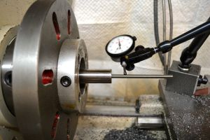 The barrel is then reversed in the head stock of the lathe.  A range rod is used to dial in the bore.
