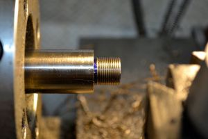 The tenon is threaded for the brake.  In this case 24 threads per inch.