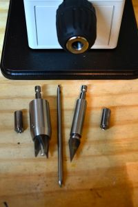 """The 3/8"""" keyless chuck accepts a myriad of attachments.  Shown here are a primer pocket cleaner (left), chamfering tool (second from left), flash hole tool (center), VLD chamfering tool (second from right), and primer pocket tool (right)."""