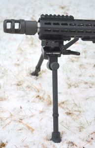 Bipod legs locked perpendicular to rifle.