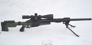 """Right side view, 24"""" 243 barrel installed."""