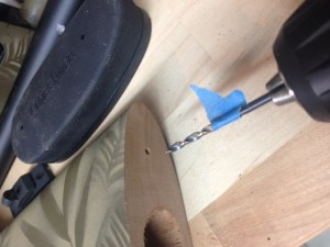 """An 1/8"""" drill bit is used to drill two pilot holes 3/4"""" deep.  The tape tells me when the holes are deep enough."""