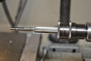 I set up a Mason piloted 223 Improved reamer in a floating reamer holder with an adjustable reamer stop.