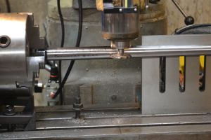 With everything set, I plunge the cutter into the barrel and start cutting the flute.
