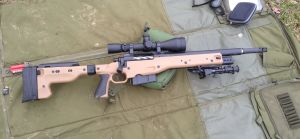 "A Remington 700, chambered in 300 Winchester Magnum with a 16.5"" barrel and Surefire muzzle brake."