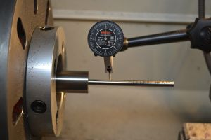 """To crown the barrel I dial in the bore on the lathe.  I'm using a Gre-tan tooling #2 range rod with a .0001"""" indicator.  Range rods have a provision for a bushing and a gradual taper.  The rod is center by the bushing and the taper."""