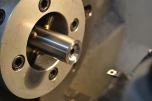 """I use a high-speed steel boring bar to cut a crown .090"""" deep with a 45 degree pull back.  I start by making a flat bottom recess with the boring bar and the retract my lathe compound at 45 degrees to make the pull back."""