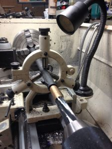 Here is my reaming set up on the lathe.  The barrel is driven by the four-jaw chuck and secured in the steady rest.  The tailstock feeds the reamer.