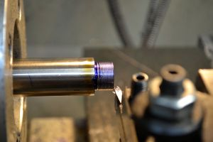 The tenon is coated in Dykem.  A high-speed steel insert tool is used to cut the threads.