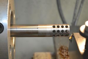 I quick pass on the lathe brings the brake down to the same diameter as the barrel.