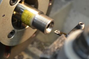 The bolt nose recess is cut with a speed steel insert boring bar.
