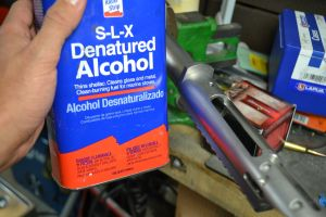 I like to use some denatured alcohol to wipe down the action and stock prior to taping the recoil lug.