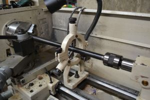 One more view of the barrel in the lathe.  With the steady rest adjusted the tail stock will be retracted.