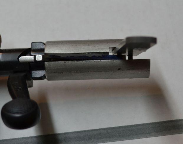 slides over firing pin shroud