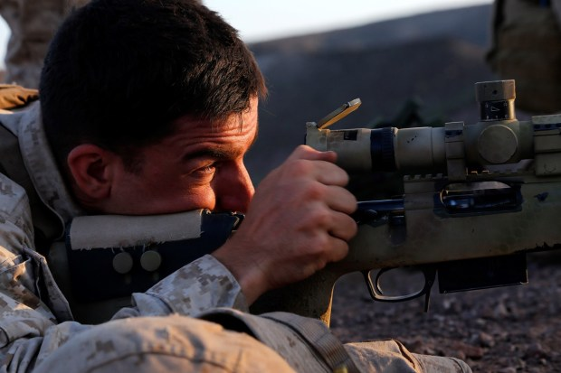 U.S. Marine Corps Cpl. Matthew D. Harris, a scout sniper team leader with Weapons Company, Battalion Landing Team 2nd Battalion, 1st Marines, 11th Marine Expeditionary Unit (MEU), and native of Butler, Indiana, provides precision fire during a live-fire and maneuver exercise as part of sustainment training at D'Arta Plage, Djibouti, Nov. 3. The 11th MEU is deployed to maintain regional security in the U.S. 5th Fleet area of responsibility. (U.S. Marine Corps photos by Gunnery Sgt. Rome M. Lazarus/Released)