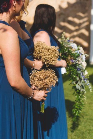 Maids Holding Bouquets for Ceremony