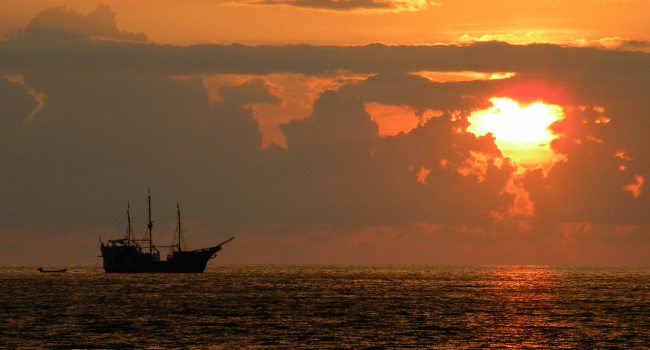 Pirate Ship and the Setting Sun, August 2009 by Paul Hamilton