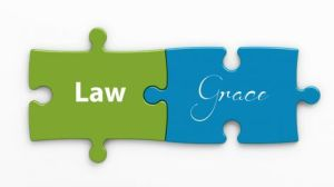 Tow Puzzle Pieces with Law on one and Grace on the other