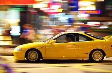 Yellow Integra Type-R Driving Through City