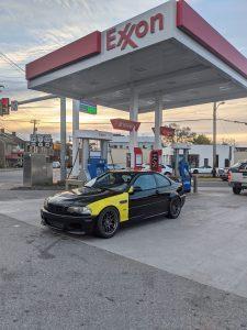 Josh's black E46 M3 at an Exxon gas station