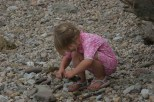 The youngest became absorbed in pebbles and sticks, abandoning the project for a while.