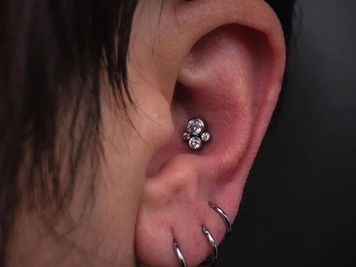 ear conch piercing