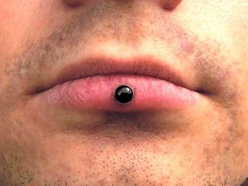 men inverse vertical labret piercing