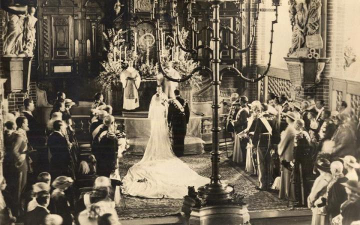 Princess Ingrid of Sweden marries Crown Prince Frederik in Stockholm Cathedral on 24 May 1935. Photo:  The Royal Collection
