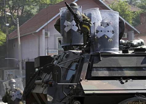 Germanys_KFOR_soldiers_aim_their_weapons_towards_Kosovo_Serbs_June_2012_Reuters