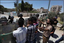 Palestinians confront IDF forces at Masara Bethlehem district at one of the weekly riots protesting the security fence and the settlements