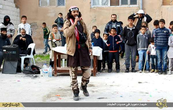 Fighter singing at an ISIS event in Tabqa