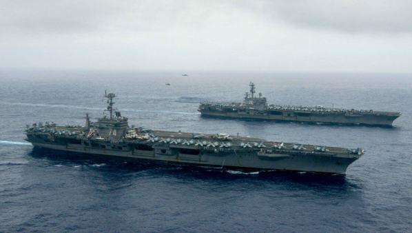USS John C. Stennis (CVN 74), center, and USS Ronald Reagan (CVN 76)