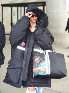 Rihanna spotted at JFK airport on October 28, 2016 big black coat